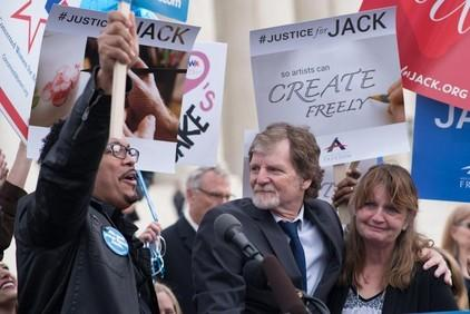 The justices voted 7-2 that the Colorado Civil Rights Commission violated Jack Phillips' (center) rights under the First Amendment